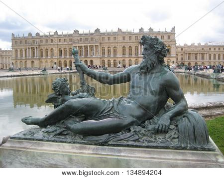 A bronze statue at The Palace of Versailles.