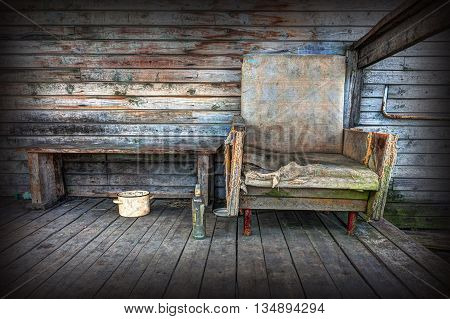 Old chair on the background of wooden wall. Photos in HDR style.