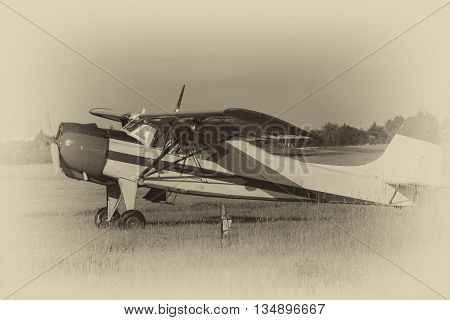 Old sports plane at the airport flying club. Stylized black and white photograph