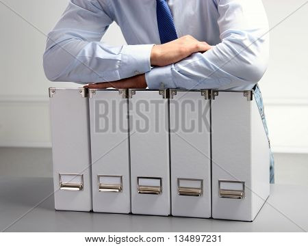 Close-up Of The Businessman With Office Folders