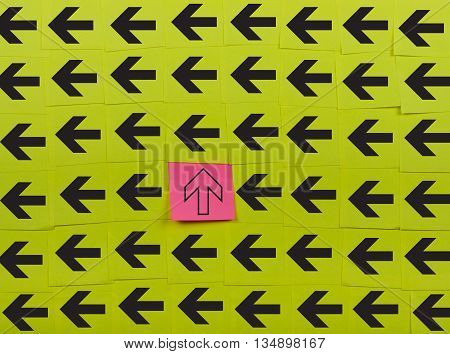 Arrows. Vertical and horizontal concept. Background of green sticky notes.