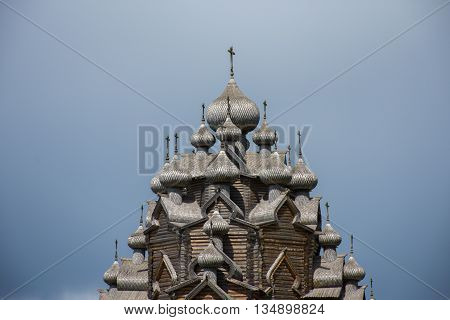 Domes with crosses of the Wooden Church of the Holy - active Orthodox temple in the Nevsky forest Park of Vsevolozhsk district of Leningrad region. Copy of Russian wooden Architecture.