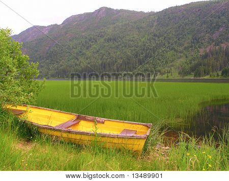 Old Wooden Boat On The Lake Bank