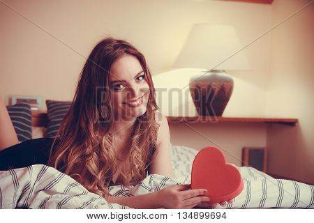 Woman In Lingerie In Bed. Valentines Day Love.