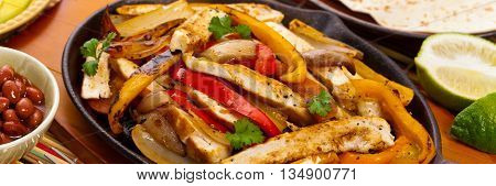 Chicken Fajitas with Grilled Onions and Bell Peppers. Selective focus.