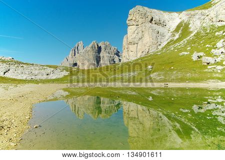Lake in the Dolomites, trekkers along the shore