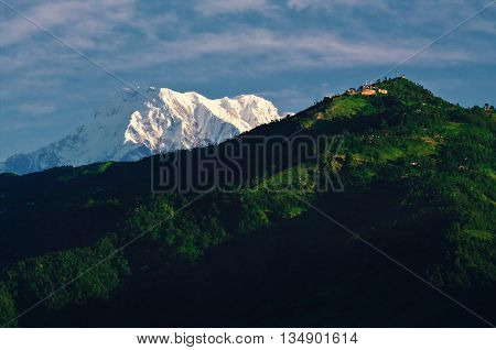 Annapurna peak, towering behind Sarangkot hill, as seen from Pokhara