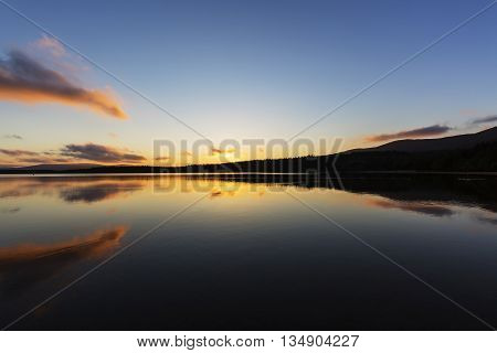 Sunset over Loch Morlich.  The atmospheric clouds reflecting off the still loch.