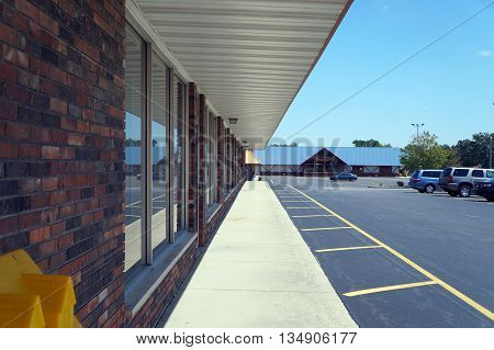 A roof provides shelter for shoppers at the Shorewood Plaza Shopping Center in Shorewood, Illinois.