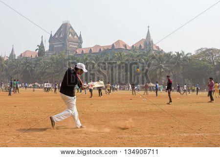 Mumbai, India - February 2, 2016: Unidentified man playing cricket in Mumbai India