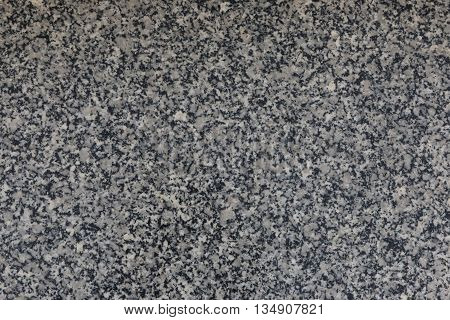 Granite rock stone pebble background texture close up