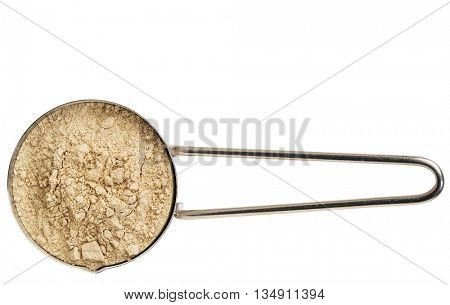 red maca root powder on a metal measuring scoop isolated on white