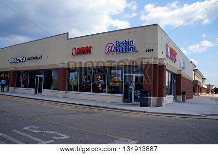 NAPERVILLE, ILLINOIS / UNITED STATES - JULY 23, 2015: People may eat Baskin Robbins' ice cream, and Dunkin' Donuts' doughnuts,  in a Naperville strip mall.