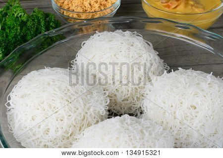 String hoppers or indiappa Sri Lankan food in wooden background