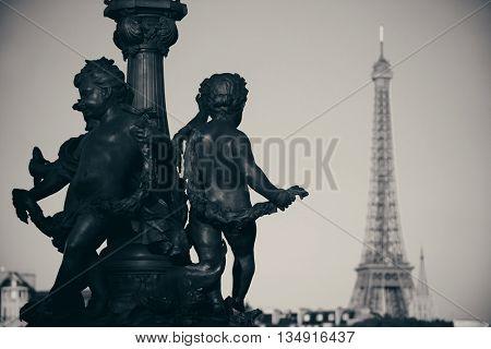 Alexandre III bridge, statue and Eiffel tower in Paris, France.