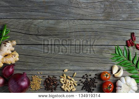 Sri Lankan spices banner dark wooden background for place text frame top view