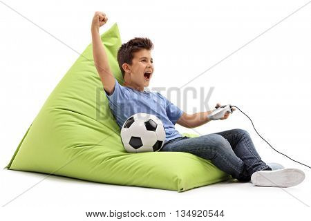 Joyful kid playing football video game and celebrating a goal isolated on white background