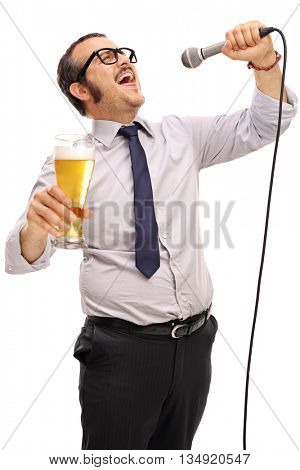 Dedicated man singing on a microphone during a karaoke and holding a pint of beer isolated on white background