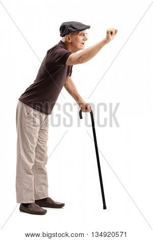 Full length portrait of a senior gentleman preparing to knock on a door isolated on white background