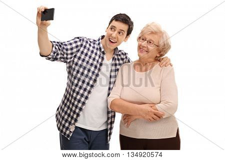 Young man and his grandmother taking selfie with cell phone isolated on white background