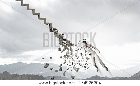 Man breaking ladder