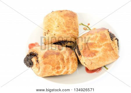 pies with poppy out of puff pastry isolated on white background