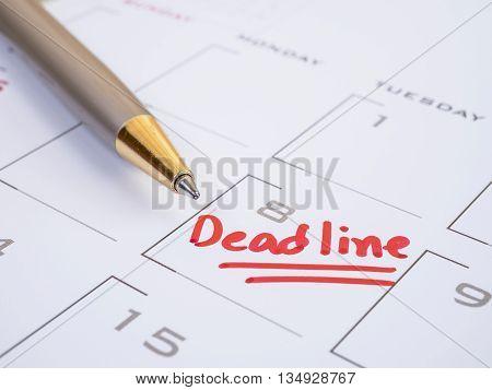 Close up handwriting word Deadline on calendar desk (Selective focus)