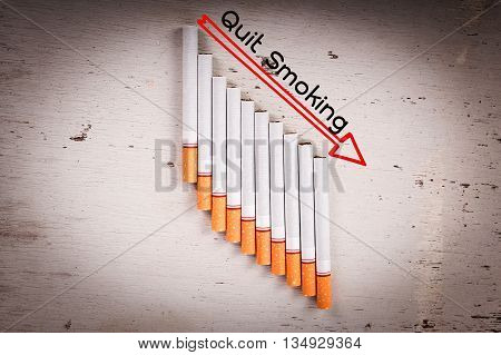 Concept No Smoking Cigarette and text Quit Smoking on wooden