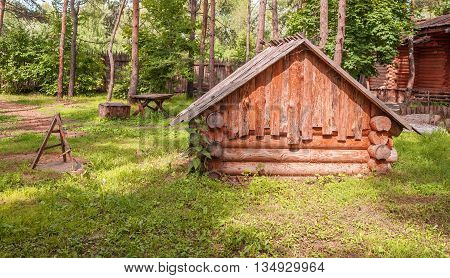 log cabin stands in a clearing in the woods