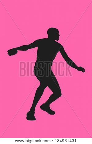 Athlete man throwing a discus against pink background