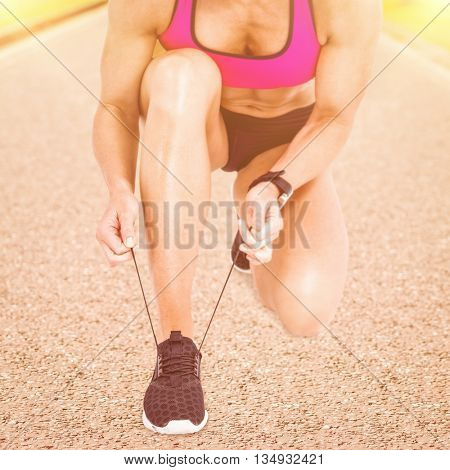 Composite image of female athlete tying her shoelace