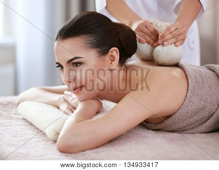 Young woman having spa procedures at the beauty salon