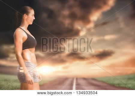 Profile view of sportswoman standing on a white background against view of an empty street
