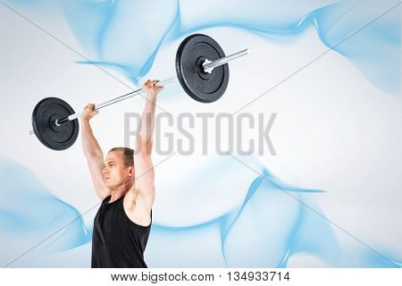 Bodybuilder lifting heavy barbell weights against grey background