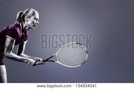Tennis player playing tennis with a racket against grey vignette