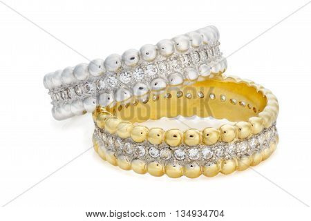 Close-up On Two Bracelets Made Of A Gold And A Silver With Diamonds
