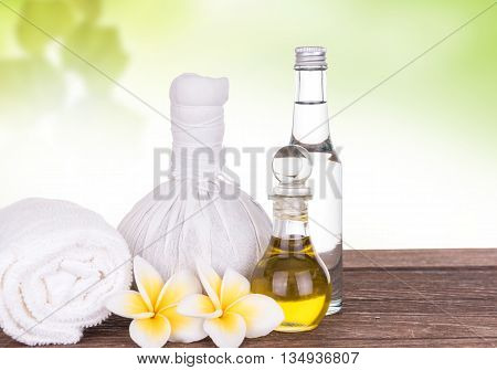 Compress with olive oil and soap in white backgroud spa concept
