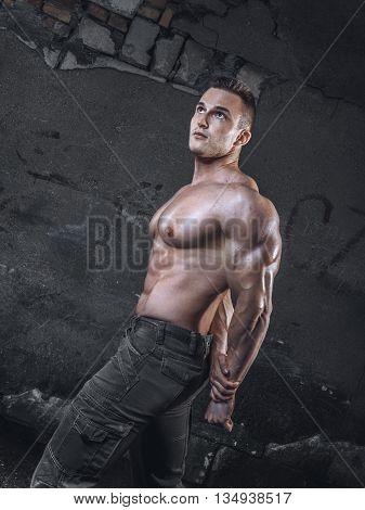 Bodybuilder On Grunge Wall