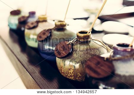 Aromatic oil in ceramic vase for traditional thai massage