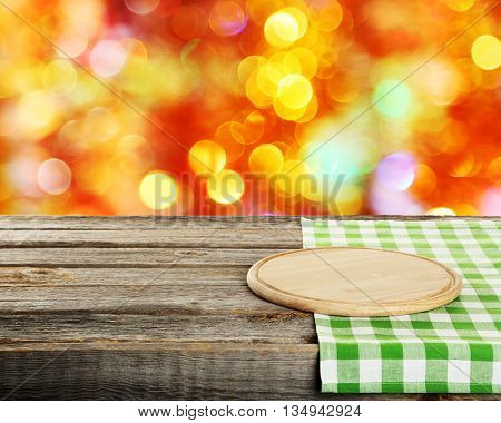 Background with wooden table with cutting board