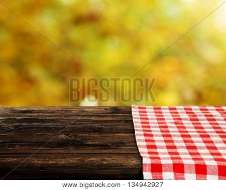 Background with wooden table with napkin, close up