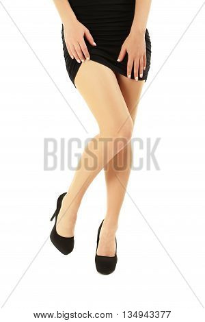 Female Legs With Black High Heels On A White Background