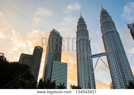 KUALA LUMPUR MALAYSIA - FEBRUARY 29: Petronas Twin Towers during evening on February 29 2016 in Kuala Lumpur Malaysia. The famous skyscraper in business district.