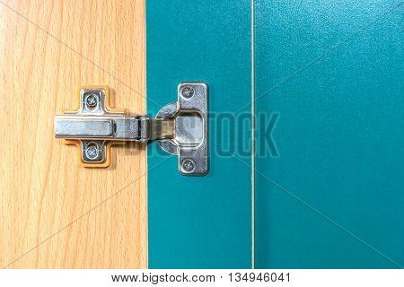 Metal hinge on the door, closeup background