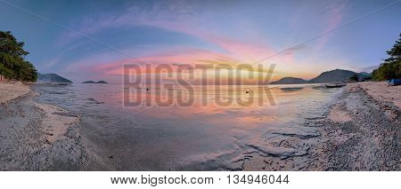 Panorama view of sunset by the muddy beach, Penang, Malaysia