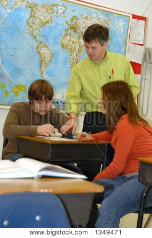 Teacher Showing Lesson To Students