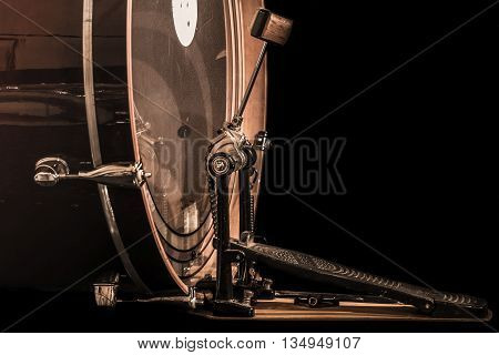 bass drum with pedal musical instrument on black background