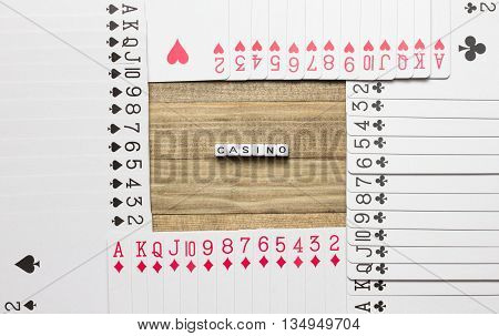 casino text cube inside border made of play card