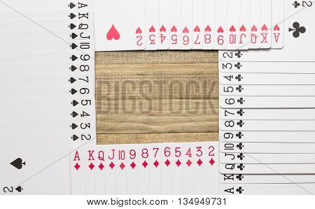 border made of play card on wooden plank