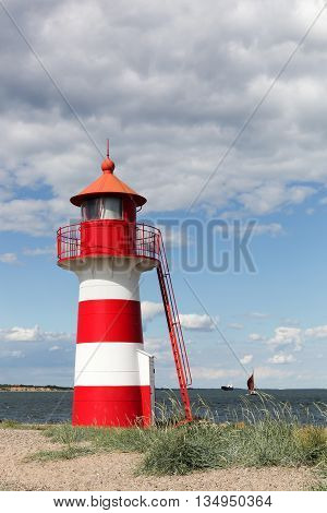The white and red lighthouse of Oddesund in Denmark